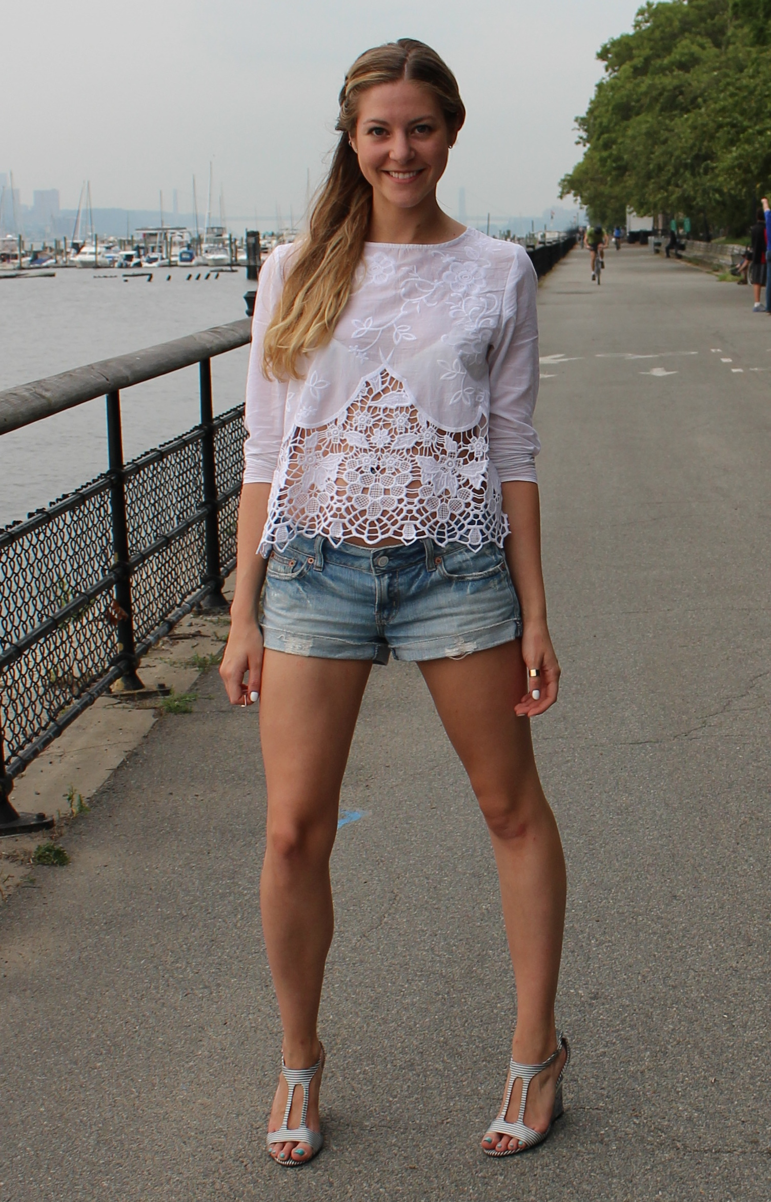 23924c468ef5 Ripped jeans and a crocheted white top with an open back is my idea of the perfect  summer outfit. After work